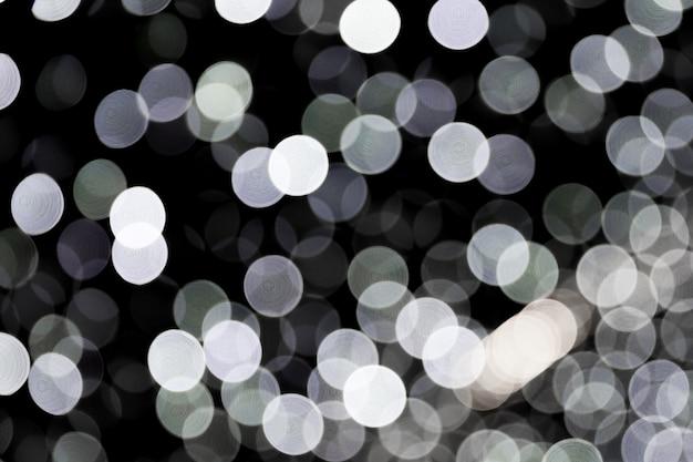 Bokeh Abstrait Des Lumières De La Ville Blanche Sur Fond Noir Photo Premium