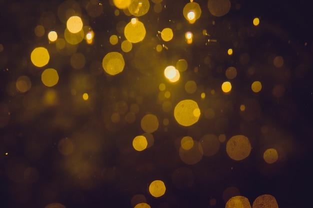 Bokeh abstrait de luxe en or sur fond noir Photo Premium