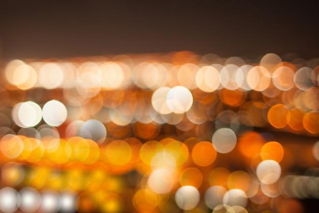 Bokeh or abstrait dans la nuit de la ville Photo Premium