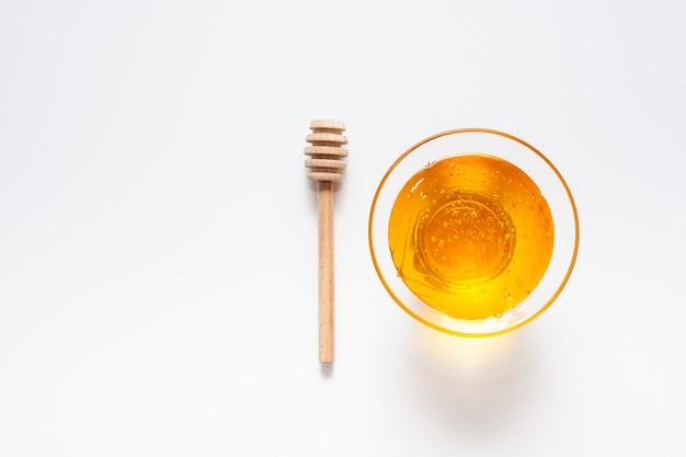Bol avec vue de dessus rempli de miel fait maison Photo gratuit