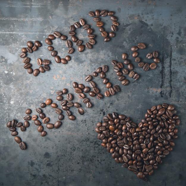 Bonjour, coeur des grains de café Photo Premium