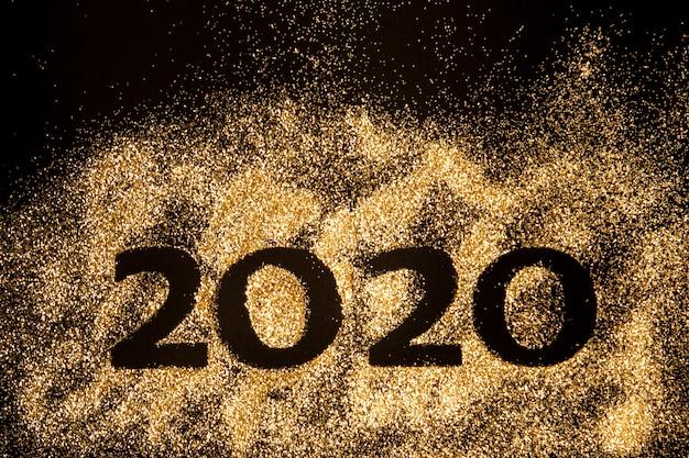 Bonne année 2020. collage créatif des nombres deux et zéro constituant l'année 2020. beau chiffre or pétillant 2020 Photo Premium