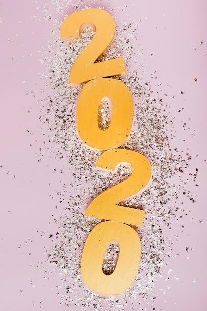 Bonne Année Avec Les Chiffres En Or 2020 Et Les Paillettes D'argent Photo gratuit