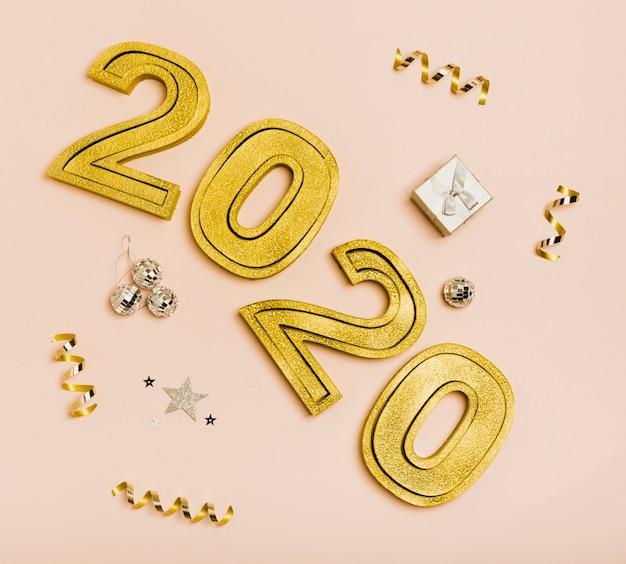 Bonne année avec les nombres en or 2020 Photo gratuit