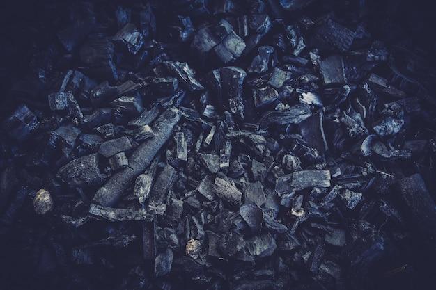 Bouchent les détails du fond de texture de charbon noir. Photo Premium