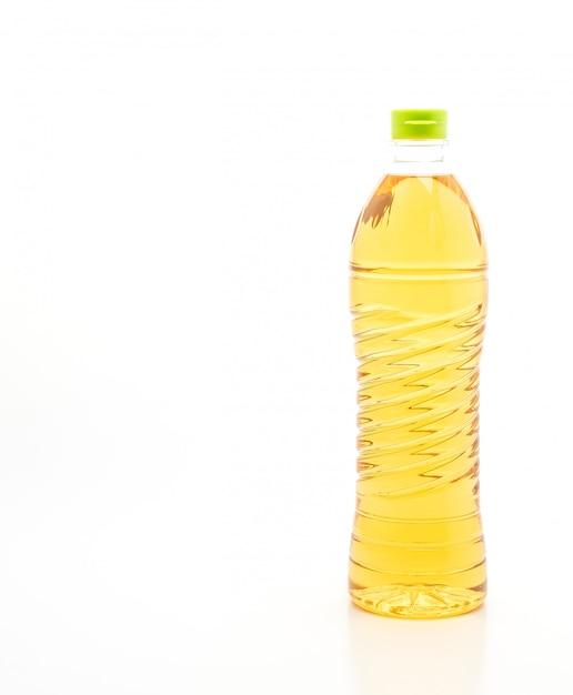 Bouteille d'huile sur fond blanc Photo Premium