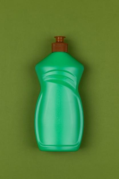 Bouteille en plastique vert clair de liquide vaisselle Photo Premium