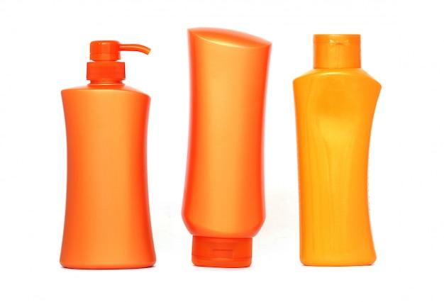 Bouteilles en plastique de produits de soin du corps et de beauté Photo Premium