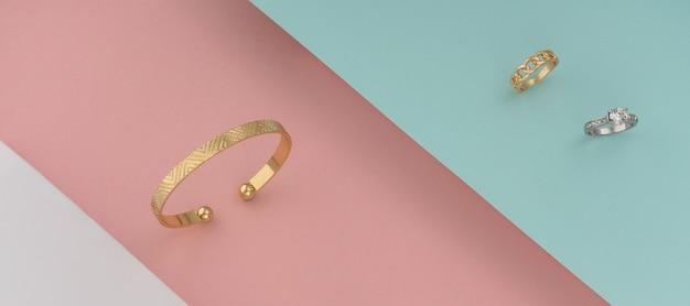 Bracelet Doré Et Bague En Or Blanc Et Diamants Sur Fond Coloré Photo Premium