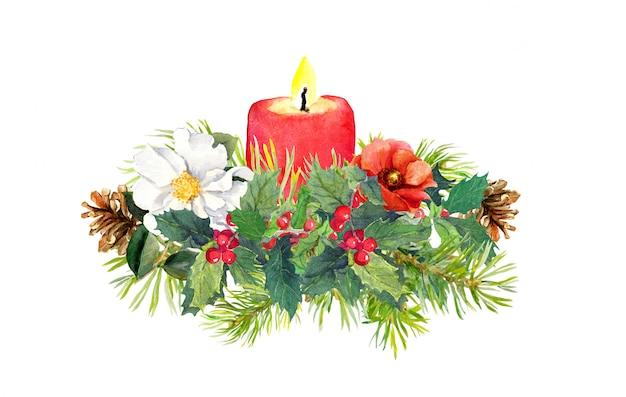 Branches de sapin de noël, bougie, plante de houx, composition de fleurs Photo Premium