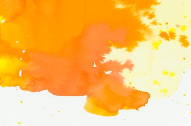 Brillant mélange de nuances d'aquarelle orange et jaune sur fond blanc Photo gratuit