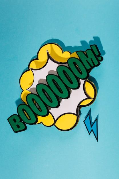 Bulle de dialogue boom rétro sur fond bleu Photo gratuit