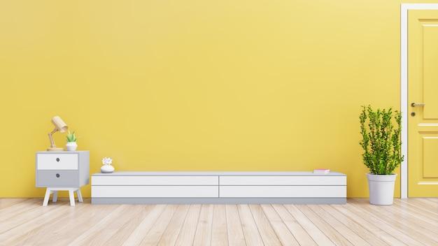 Cabinet pour objet de télévision ou de lieu dans le salon moderne avec lampe, table, plante sur fond de mur jaune, rendu 3d Photo Premium