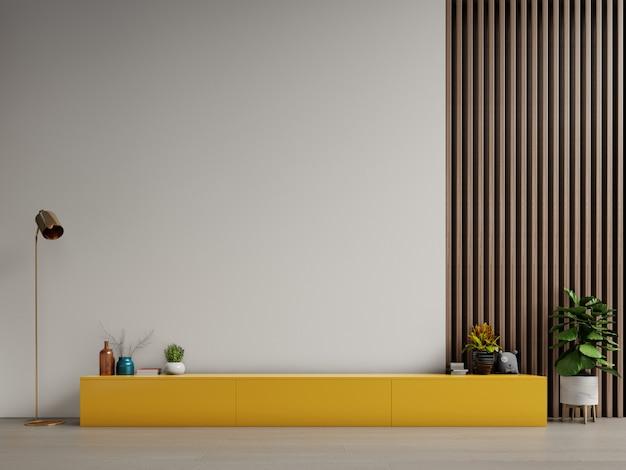 Cabinet pour la télévision ou placer l'objet dans le salon moderne avec lampe, table, fleur et plante sur fond de mur blanc. Photo Premium