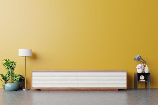 Cabinet pour la télévision ou placer un objet dans le salon moderne avec lampe Photo Premium