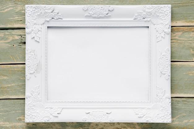 Cadre blanc sur fond en bois Photo gratuit