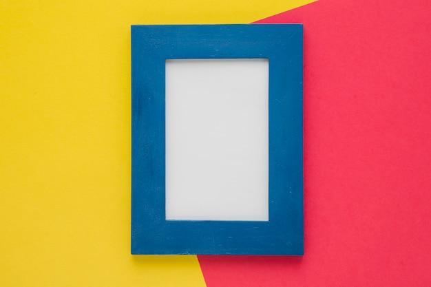 Cadre bleu vertical avec fond bicolore Photo gratuit
