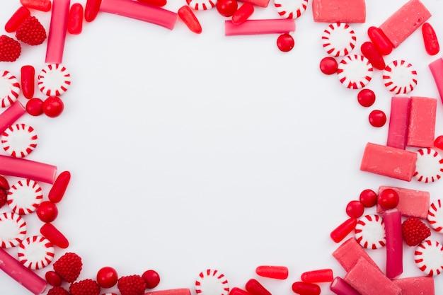 Cadre de gelées de fruits et de sucreries Photo gratuit