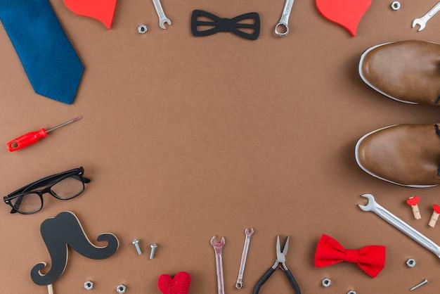 Cadre des outils et vêtements homme Photo gratuit