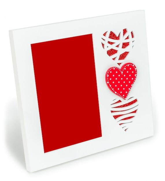 Cadre photo blanc avec des coeurs rouges Photo Premium
