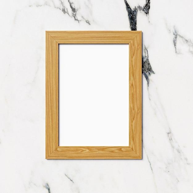 Cadre photo en bois sur fond de marbre Photo Premium