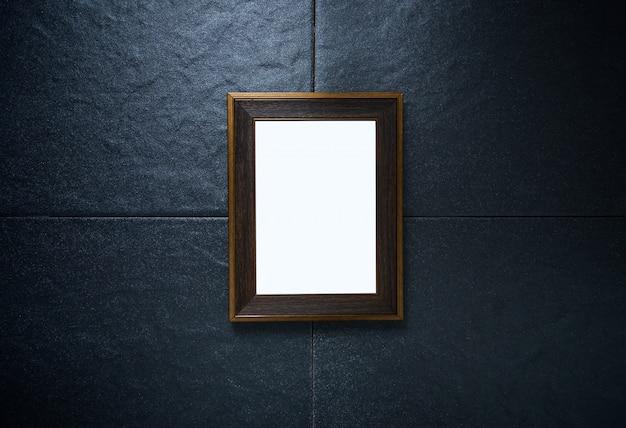 Cadre photo sur mur de pierre noire Photo Premium