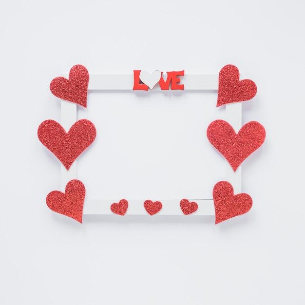 Cadre photo avec titre d'amour et symboles du coeur Photo gratuit