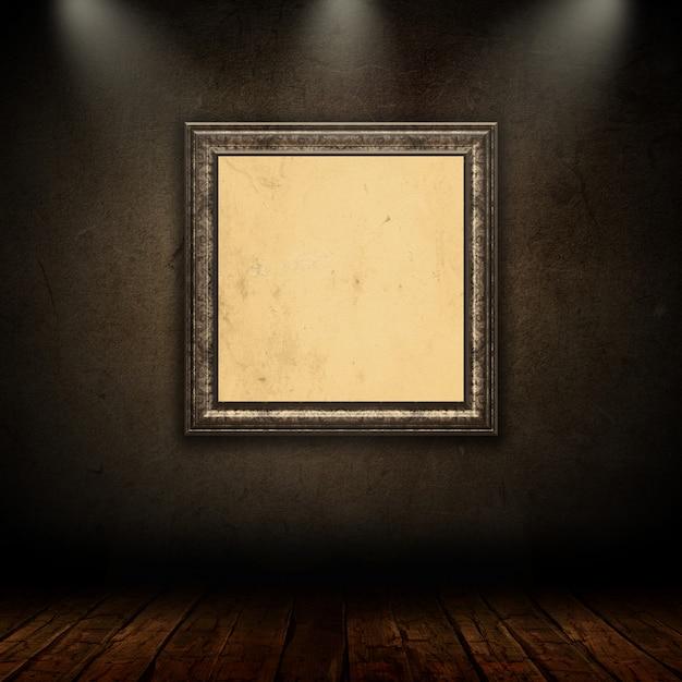 Cadre photo vintage blanc dans la salle de grunge avec des projecteurs Photo gratuit