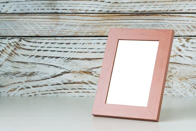 Cadre sur table en bois Photo gratuit