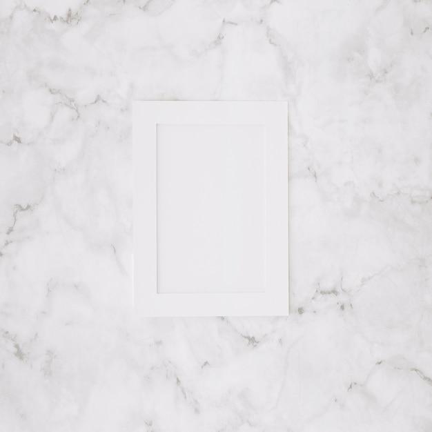 Cadre vide blanc sur fond texturé en marbre Photo gratuit