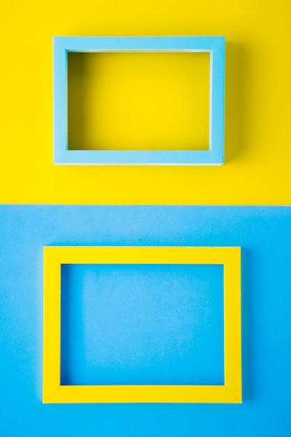 Cadres de couleurs vives sur fond bicolore Photo gratuit