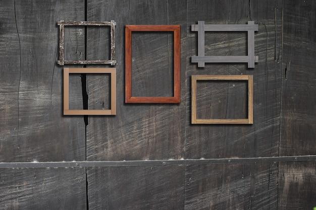 Cadres photo vintage sur un mur en bois pour intérieur ou arrière-plan. Photo Premium