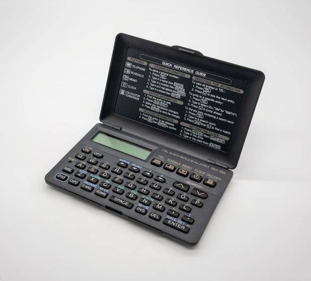 Calculatrice pliable de poche vintage isolé sur blanc Photo Premium