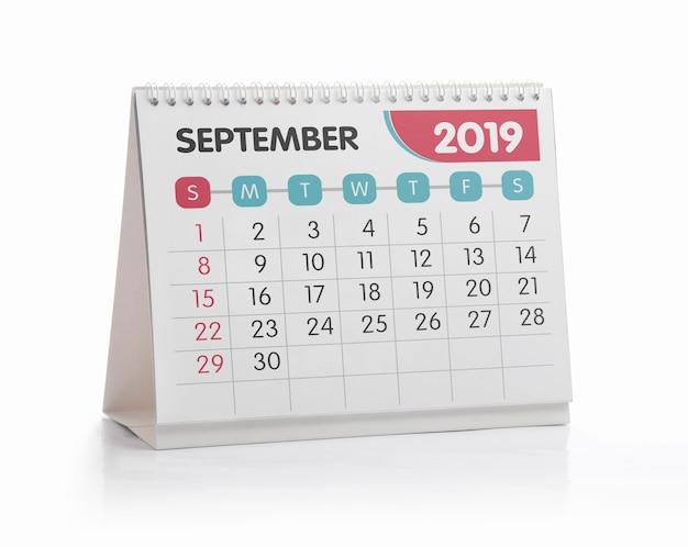 Calendrier blanc de bureau de septembre 2019 isolé sur blanc Photo Premium