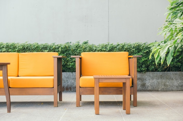 Canapé et chaise en bois Photo gratuit