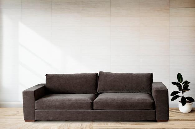 Canapé par un mur carrelé Photo gratuit