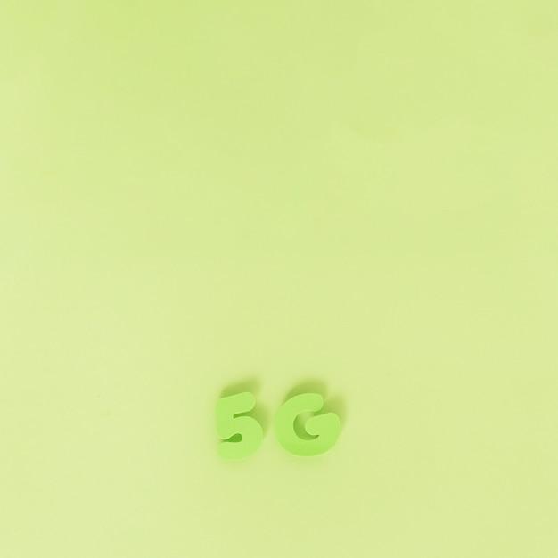 Caractères 5g sur fond uni Photo gratuit