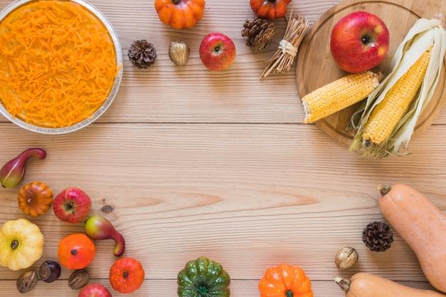 Carotte en assiette entre différents légumes Photo gratuit