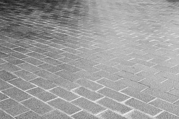 Carreaux de pavage à motifs modernes, fond de plancher de brique de ciment - monochrome Photo Premium