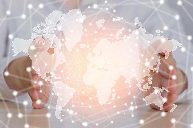 Carte Du Monde Concept De Mondialisation Entre Les Empreintes De Mains D'une Fille. Photo Premium