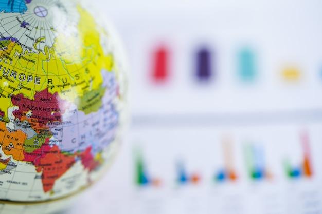 Carte du monde globe sur graphique Photo Premium