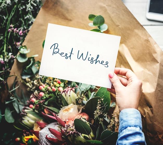 Carte meilleurs voeux avec un bouquet de fleurs Photo Premium