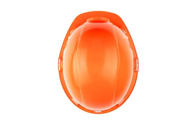 Casque de chantier orange. le concept d'architecture, construction, ingénierie, conception. espace de copie. top voir Photo Premium