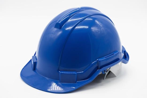 Casque ingénieur de sécurité bleu sur blanc Photo Premium