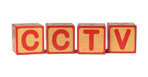 Cctv Sur Bloc D'alphabet Pour Enfants En Bois Coloré Isolé Sur Blanc. Photo Premium