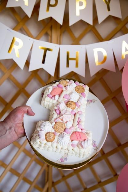 Célébrer le premier anniversaire. fond de photo pour célébrer son premier anniversaire Photo Premium
