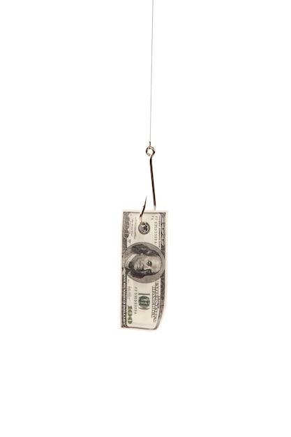 Cent dollars sur le crochet de pêche isolé sur fond blanc Photo gratuit