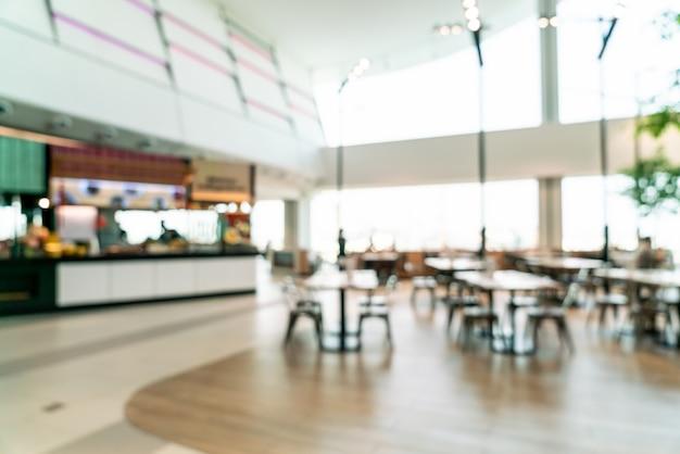 Centre de cour de nourriture flou abstrait et défocalisé dans un centre commercial Photo Premium