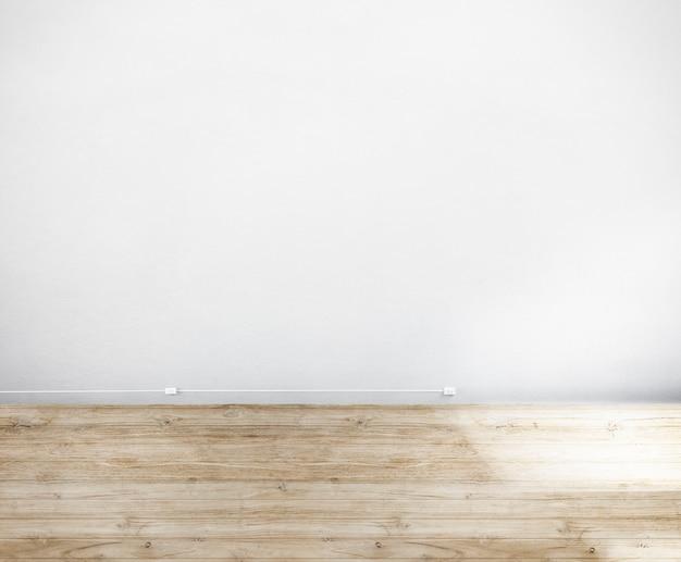 Chambre faite de mur blanc et plancher en bois Photo gratuit