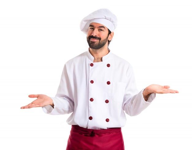 Chef Ayant Des Doutes Sur Fond Blanc Photo gratuit